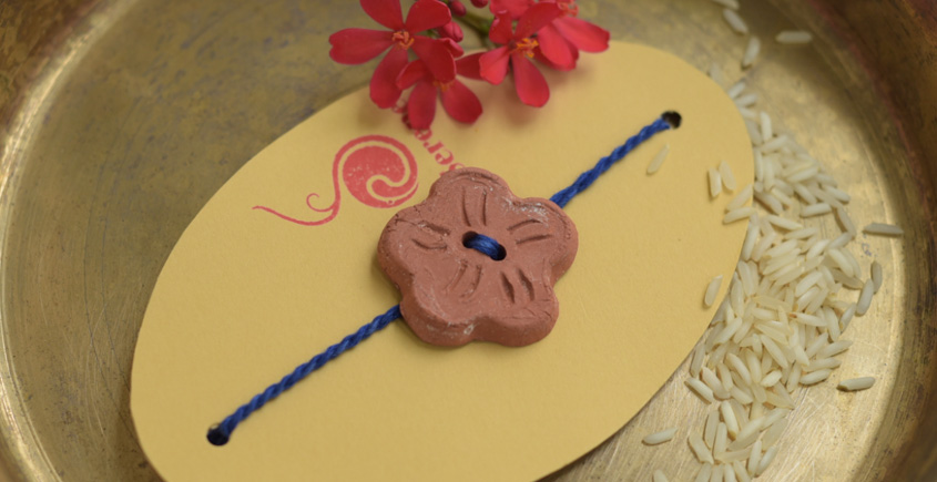 Terracotta ❂ Handmade . Rakhi { e }